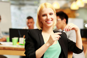 Happy businesswoman sitting in office