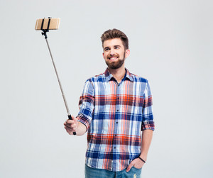 Happy casual man making selfie photo