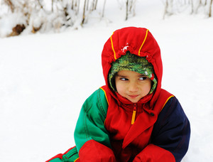 Happy child in snow, white winter