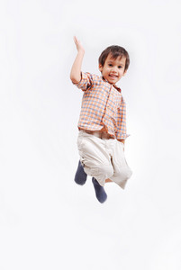 Happy child is jumping high