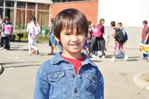 Happy children in front of the school