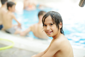Happy children on swimming pool