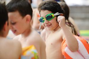 Happy children on swimming pool