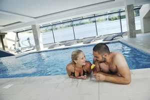 Happy cople at swimming pool