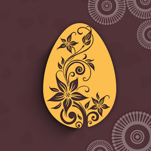 Happy Easter Background Or Card With Floral Decorated Egg On Brown Background.