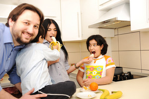 Happy family of four members in kitchen