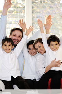 Happy family with raised arms