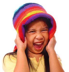Happy Girl Having Great Fun And Wearing A Hat