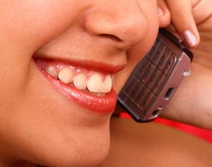 Happy Girl Making A Telephone Call
