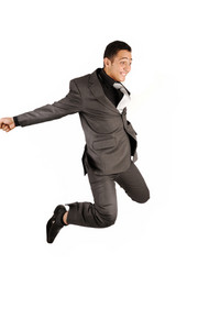 Happy jumping businessman who celebrates success