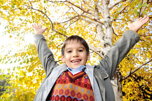 Happy kid in autumn park portrait