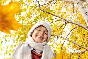 Happy kid in autumn park portrait