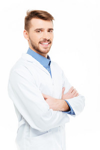 Happy male doctor standing with arms folded isolated on a white background