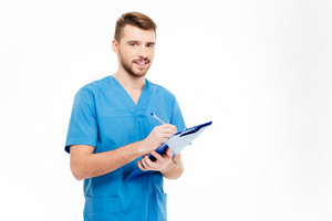 Happy male doctor standing with clipboard isolated on a white background