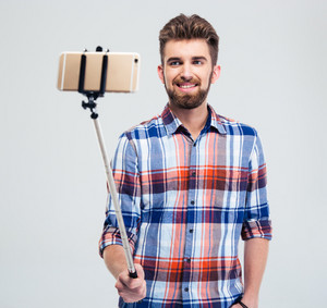 Happy man making selfie photo