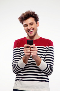 Happy man using smartphone over gray background