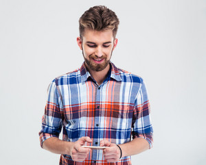 Happy man using smartphone