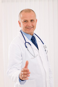 Happy mature doctor male giving handshake welcoming portrait