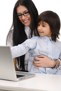 Happy mother and son on laptop at the table