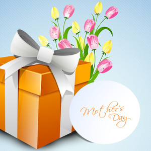 Happy Mothers Day Concept With A Gift Box And Flowers With Tag