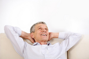 Happy relaxed elderly man at home