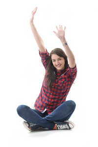 Happy sitting girl waving her arms isolated on white background