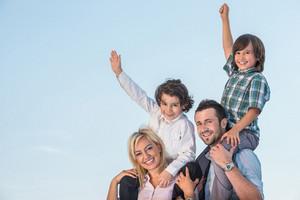 Happy smiling family having fun outdoors