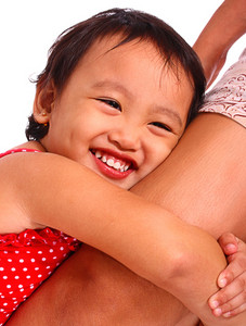 Happy Smiling Girl Hugging Her Mother's Leg