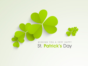 Happy St. Patrick's Day Background With Clover Leafs On Shiny Green Background.