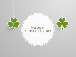 Happy St. Patrick's Day Celebration Concept With Hanging Clover Leaves And Stylish Text Sticker On Grey Background.