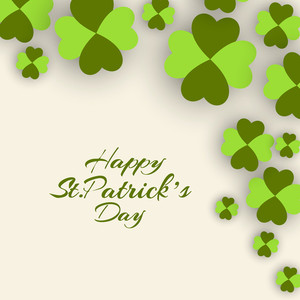 Happy St. Patricks Day Celebration Concept With Shiny Clover Leaves On Grungy Green Background