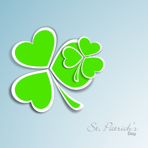 Happy St. Patrick's Day Concept With Beautiful Clover Leaves In Green Color On Shiny Blue Background.