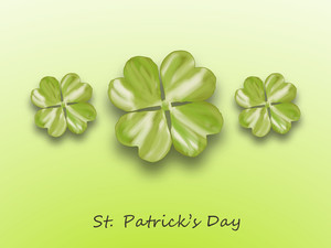 Happy St. Patrick's Day Concept With Beautiful Clover Leaves On Shiy Green Background.
