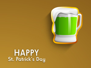 Happy St. Patrick's Day Concept With Beer Mug On Brown Background.