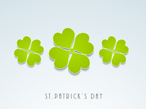 Happy St. Patricks Day Concept With Clover Leaves In Green Color On Blue Background.