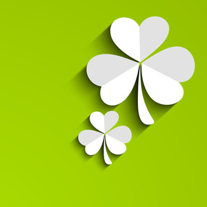Happy St. Patricks Day Concept With Clover Leaves On Shiny Green Background.