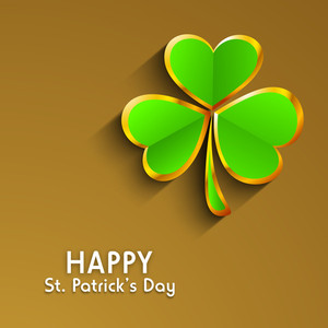 Happy St. Patricks Day Concept With Glossy Green And Golden Clover Leave On Shiny Brown Background.