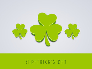 Happy St. Patrick's Day Concept With Glossy Green Clover Leafs On Grey And Green Background.
