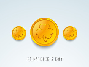 Happy St. Patrick's Day Concept With Gold Coins Having Clover Leaf Design On Blue Background.