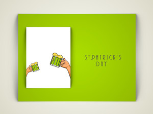 Happy St. Patricks Day Concept With Human Hand Holding Beer Mugs On White And Green Background.