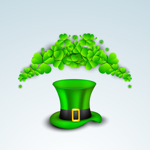 Happy St. Patricks Day Concept With Leprechaun Hat And Clover Leaves On Blue Background.