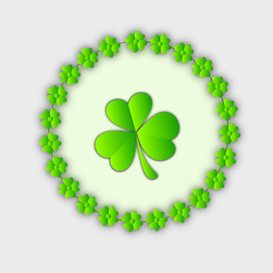Happy St. Patrick's Day Concept With Shiny Clover Leaves On Grey Background.