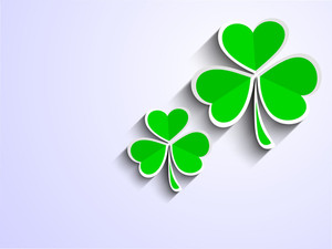 Happy St. Patricks Day With Clover Leaves On Purple Background.
