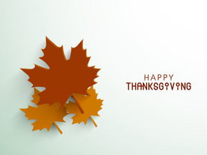 Happy Thanksgiving Day Concept With Beautiful Autumn Leaves On Green Background.