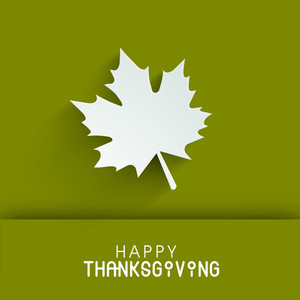 Happy Thanksgiving Day Concept With Beautiful White Autukn Leave On Green Background.