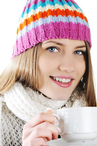 Happy Winter Beautiful Girl drinking hot tea
