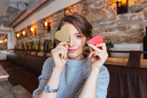 Happy woman holding red heart