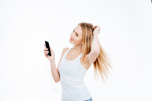 Happy woman listening music on smartphone isolated on a white background