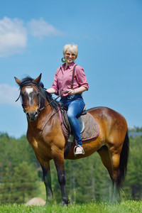 Happy woman on horse