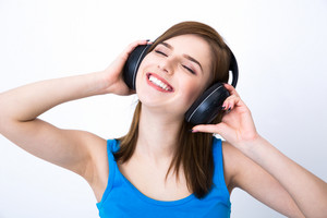 Happy woman with headphones listening music